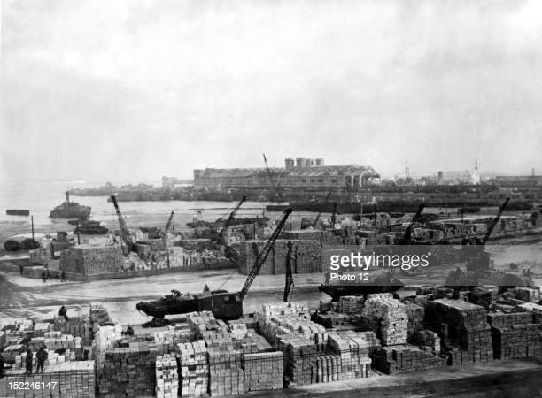 In Cherbourg American amphibious 'ducks' are being unloaded in the vicinity of the Place Napoleon and supplies are stacked up for the Allied drive...