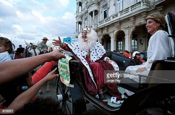 In conjunction with a holiday tradition a Spanish diplomat dressed as 'The Magician King' parades down the streets of Havana Cuba January 8 greeting...