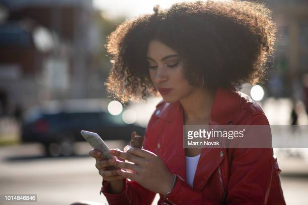 In connection - teen girl on phone in street
