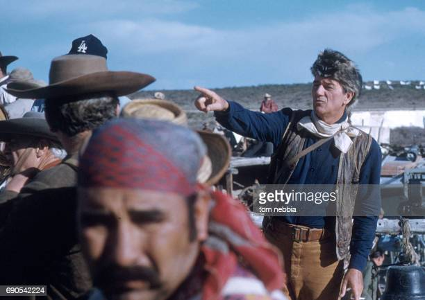 In costume American actor John Wayne directs crew members in the scene from his film 'The Alamo' Brackettville Texas 1960