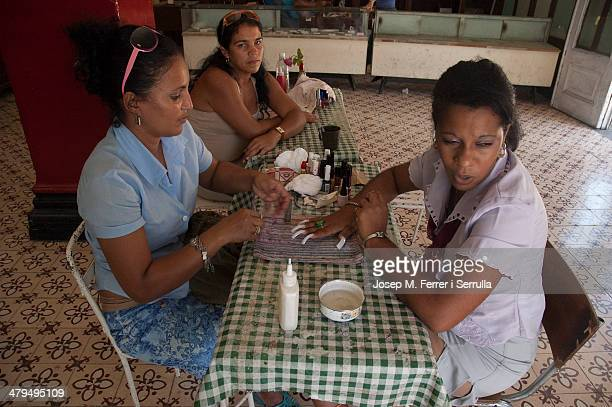 "In Cuba, the craft of making manicure is labeled ""cuentapropista."" It is one of the few private initiatives that the government censorship and help..."