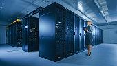data center female it specialist walks