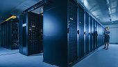 data center female it technician running