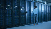 data center male it technician running