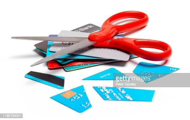 in debt, cut up credit card - cutting stock pictures, royalty-free photos & images