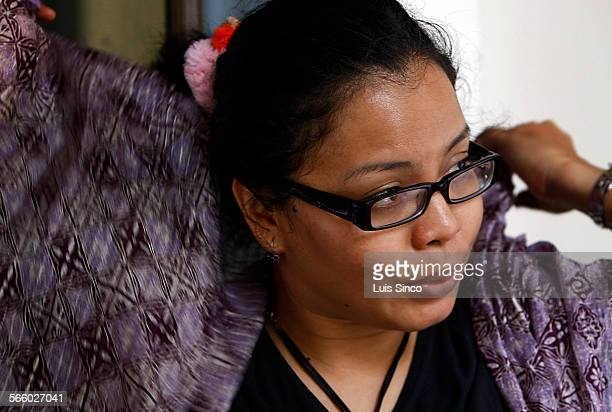 In donesian human rights activist Norma Manalu puts on a purple silk jilbab teven though she regards the elegant garment as a shackle ÒIts hot Its...
