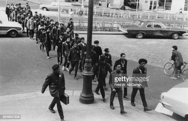 In doublefile lines members of the Black Panther Party cross a street near the Federal courthouse on their way to a demonstration New York New York...