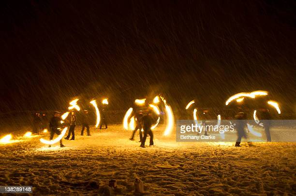 In driving snow torches representing the return of the sun are used in a symbolic battle against winter on February 4 2012 in Huddersfield England...