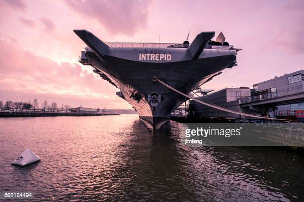 u.s.s. intrepid in dusk - aircraft carrier stock pictures, royalty-free photos & images