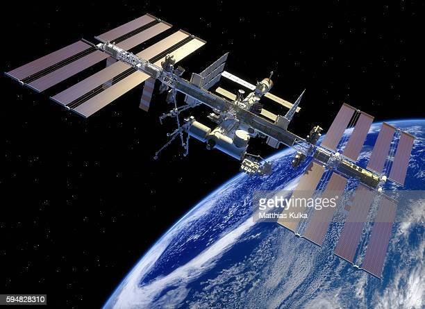 iss in earth orbit - international space station stock pictures, royalty-free photos & images