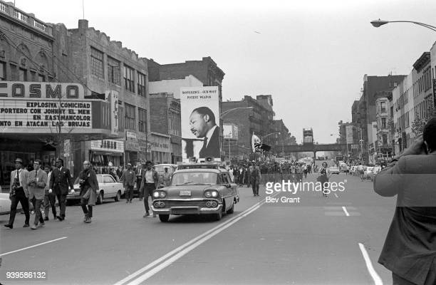 In East Harlem a car leads the Poor People's Campaign 1968 march along East 116th Street East Harlem New York New York May 11 1968 The poster reads...