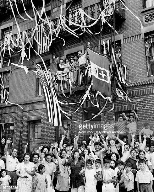 In East Harlem crowds in street raise a cheer for the end of World War II