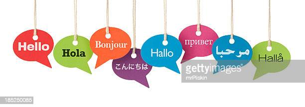 hello in eight different languages - greeting stock pictures, royalty-free photos & images