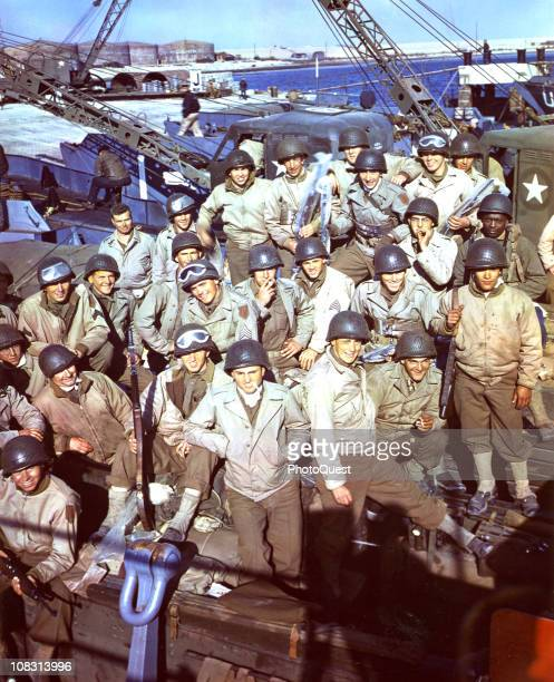 In England American soldiers having loaded their equipment and supplies onto an LCT await the signal to begin the DDay invasion June 1944