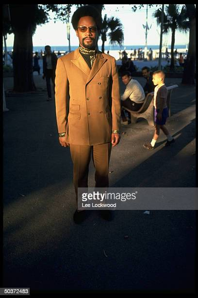 In exile from US Black Panther Eldridge Cleaver standing outdoors wearing sunglasses