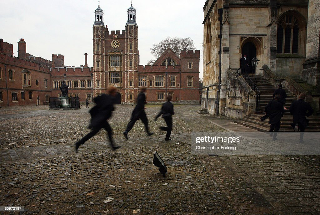 In fear of being late, boys race their way to chapel across the historic cobbled School Yard of Eton College on November 17, 2007 in Eton, England. An icon amongst private schools, since its founding in 1440 by King Henry VI, Eton has educated 18 British Prime Ministers, as well as prominent authors, artists and members of royal families from around the world. The school caters for some 1300 pupils divided into 25 houses each one overseen by a housemaster chosen from the senior ranks of the staff which number around 160.