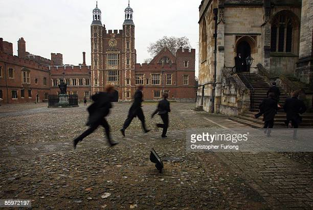In fear of being late boys race their way to chapel across the historic cobbled School Yard of Eton College on November 17 2007 in Eton England An...
