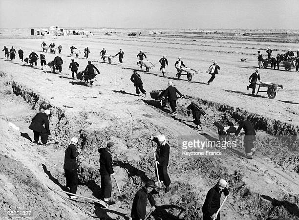 In February 1958 During The Great Leap Forward Inhabitants Of The City Of YangKula In Shantung Province China Toil Away At Building A Water Reservoir...