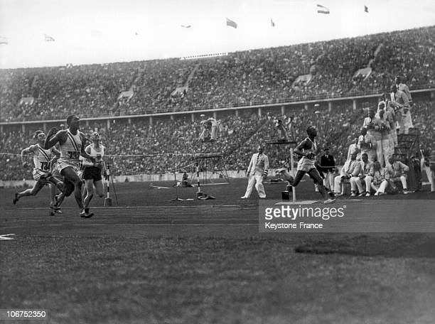 In Finishing Order The American Sprinters Jesse Owens And Ralph Metcalfe The Dutch Martinus Osendarp And The American Frank Wykoff At The Finish Line...