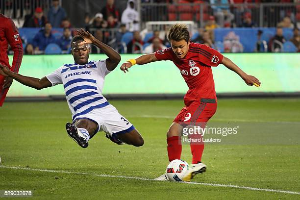 TORONTO ON MAY 7 In first half action FC Dallas defender Maynor Figueroa tries some defence but Toronto FC forward Tsubasa Endoh kicks and scores The...