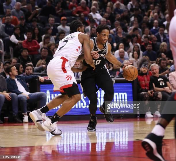 February 22: In first half action, San Antonio Spurs guard DeMar DeRozan tries to work around Toronto Raptors forward Kawhi Leonard The Toronto...