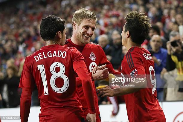 TORONTO ON MAY 7 In first half action Toronto FC defender Damien Perquis and Toronto FC midfielder Marco Delgado celebrate Toronto FC forward Tsubasa...