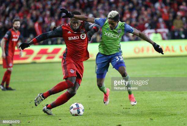 TORONTO ON DECEMBER 9 In first half action Toronto FC forward Jozy Altidore and Seattle Sounders defender Joevin Jones battle for the ball The TFC...