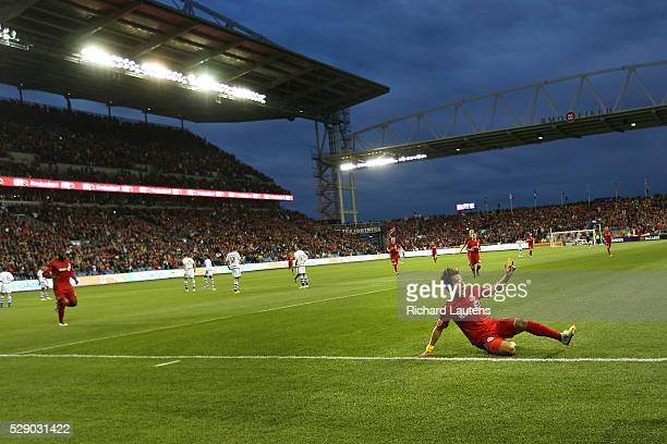 TORONTO ON MAY 7 In first half action Toronto FC forward Tsubasa Endoh slides along the grass after scoring a goal in the new partly covered stadium...