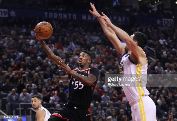 TORONTO ON JANUARY 13 In first half action Toronto Raptors guard Delon Wright takes a shot around Golden State Warriors center Zaza Pachulia The...