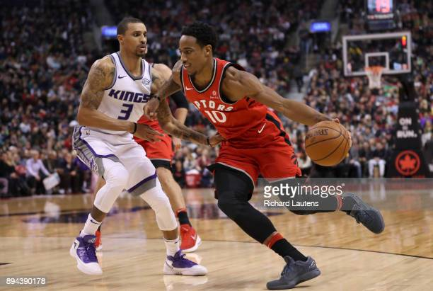 TORONTO ON DECEMBER 17 In first half action Toronto Raptors guard DeMar DeRozan drives around Sacramento Kings guard George Hill The Toronto Raptors...