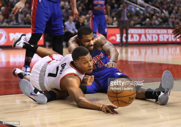 TORONTO ON FEBRUARY 12 In first half action Toronto Raptors guard Kyle Lowry and Detroit Pistons forward Marcus Morris battle for the ball under the...