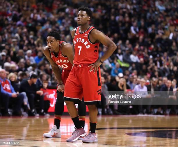 TORONTO ON DECEMBER 17 In first half action Toronto Raptors guard Kyle Lowry and Toronto Raptors guard DeMar DeRozan watch a free throw The Toronto...