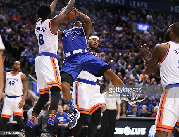 TORONTO ON NOVEMBER 12 In first half action Toronto Raptors guard Kyle Lowry gets some grief form New York Knicks guard Justin Holiday and New York...