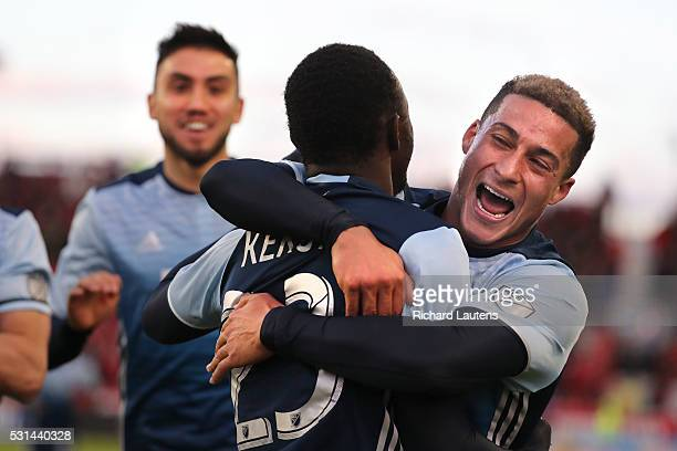 TORONTO ON MAY 14 In first half action Vancouver Whitecaps forward Erik Hurtado gives a big hug to Vancouver Whitecaps forward Kekuta Manneh...