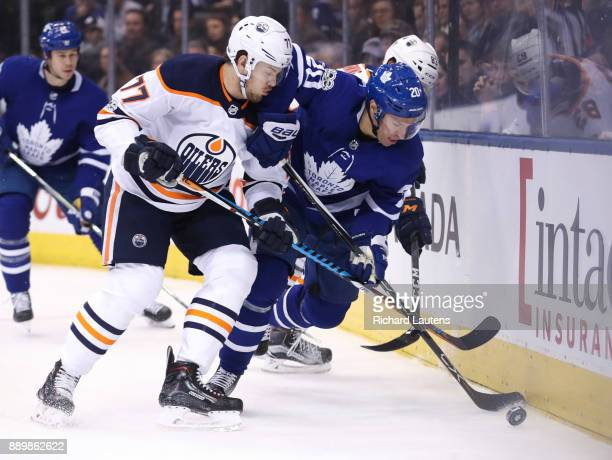 TORONTO ON DECEMBER 10 In first period action Edmonton Oilers defenseman Oscar Klefbom and Toronto Maple Leafs center Dominic Moore battle for the...