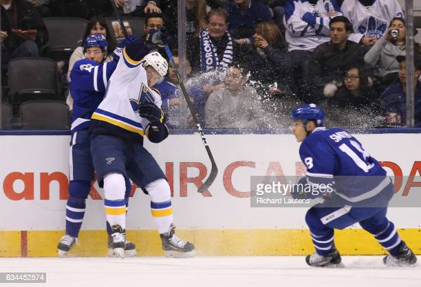 TORONTO ON FEBRUARY 9 In first period action Toronto Maple Leafs center Auston Matthews and St Louis Blues center Ivan Barbashev mix it up along the...