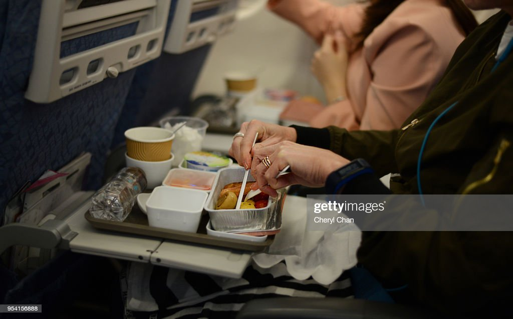 In Flight Meal - Enjoying breakfast : Stock Photo
