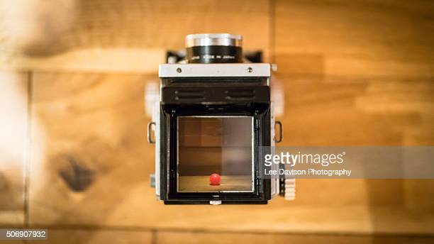 in focus - photographic film camera stock photos and pictures