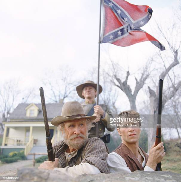 In foreground from left to right Lloyd Bridges and John Hammond prepare to defend the Geyser farm from Union Army soldiers A Confederate flag is...