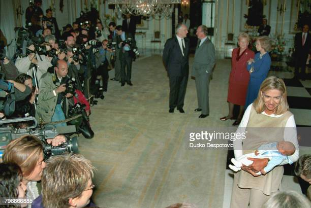 In foreground Infanta Christina with baby Pablo Nicolas in background Juan Maria Urdangarin talking to King Juan Carlos Claire Urdangarin and Queen...