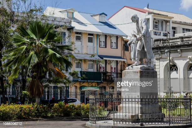 in fort de france, on the old courthouse grounds, statue of victor schoelcher. the place is now open to the public, no entrance fee, where residents and tourists can wander around, being inside and outside. - martinique stock photos and pictures