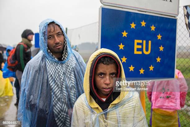 In freezing cold and heavy rain refugees wait to cross at the Timovec border crossing between Croatia and Slovenia