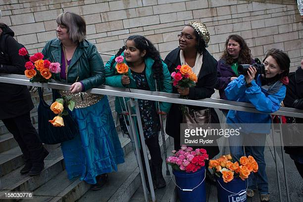 In front from left Jacquelyn Krones Laura DeMarco Christine EdgarDeMarco and Heather Buchanan wait outside of City Hall to congratulate newlyweds on...