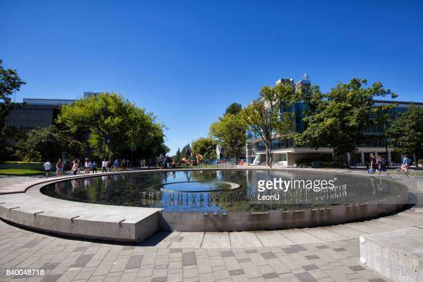 in front of a fountain in ubc, vancouver, canada - ubc stock pictures, royalty-free photos & images