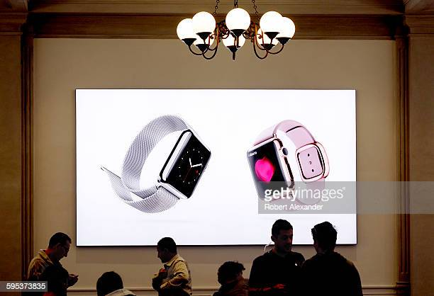 In front of a sign promoting the new Apple Watches customers shop in the new Apple Store which opened in Florence Italy in September 2015 It is...