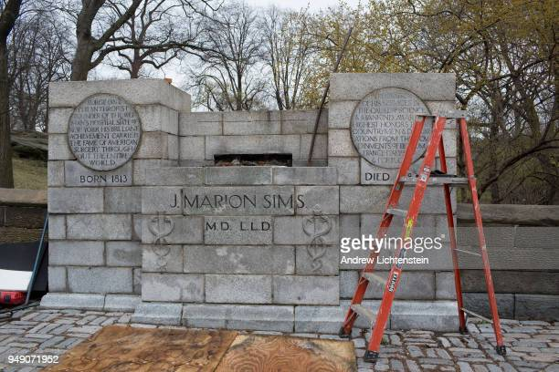 In front of a small crowd of activists and media city workers remove a statue of J Marion Sims a surgeon and medical pioneer in the field of...