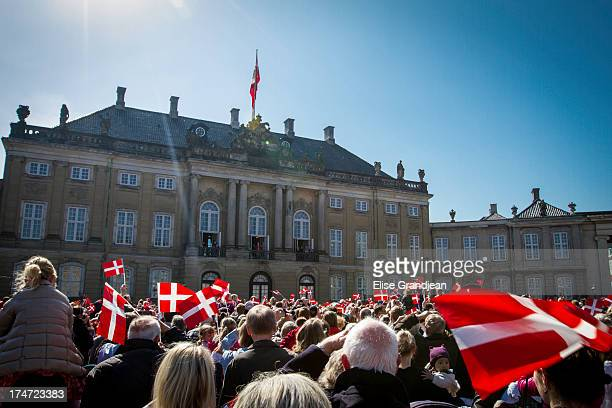 In front of Amalienborg palace, a huge crowd with Danish flags greeted the queen Margrethe II of Denmark who celebrated her 73th Birthday and...