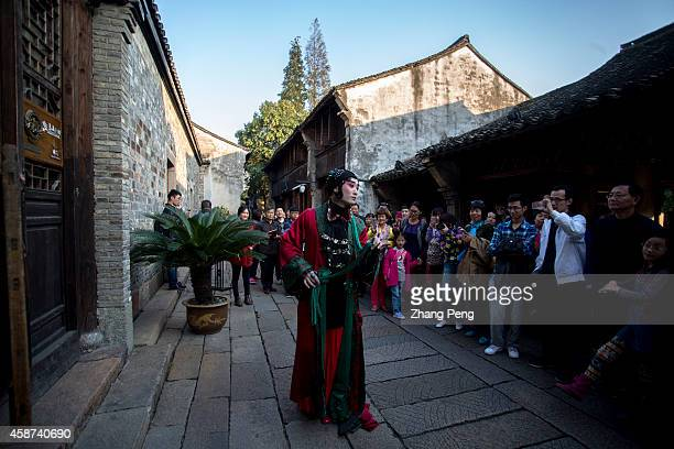 WUZHEN TONGXIANG ZHEJIANG CHINA In front of an ancient architecture a male Peking Opera artist is acting a female character which is called...