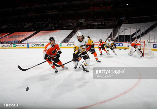 In front of an empty arena, the Philadelphia Flyers skate against the Pittsburgh Penguins at the Wells Fargo Center on January 13, 2021 in...