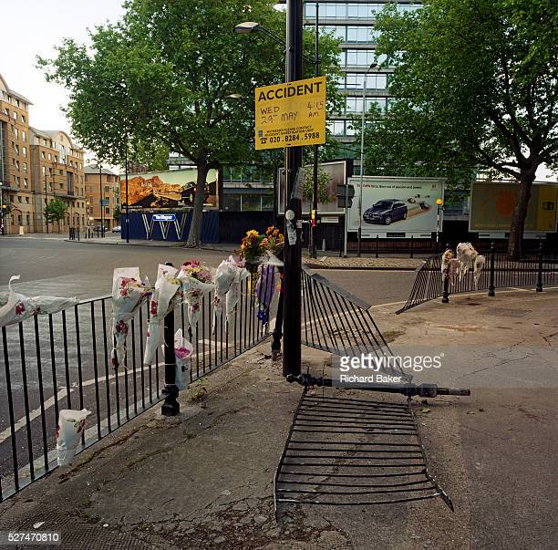 In front of car ad billboards a memorial has been placed where 'Jay' died on St George's Circus London England If we drove past this place where...